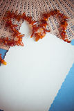 Blue background with amber beads for design Stock Photography