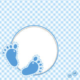 Blue background with baby footsteps. Blue tablecloth background with baby footsteps Royalty Free Stock Images