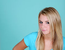 Blue background with blonde girl Stock Photography
