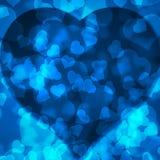 Blue background blurred lights heart. Blue background of blurred lights in the shape of a heart Royalty Free Stock Image