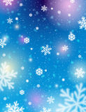 Blue background with bokeh and blurred snowflakes, vector Royalty Free Stock Image