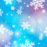Blue background with bokeh and blurred snowflakes, vector Stock Image