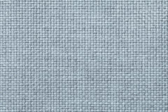 Blue background with braided checkered pattern, closeup. Texture of the weaving fabric, macro. Light blue background with braided checkered pattern, closeup Stock Image