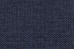 Blue background with braided checkered pattern, closeup. Texture of the weaving fabric, macro. Royalty Free Stock Photo