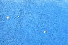 Blue background with cement texture. And dry leaves Stock Photos