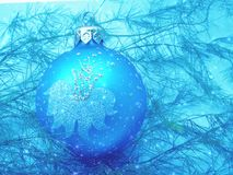 Blue background with Christmas toy Stock Photos