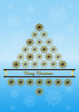 Blue background with Christmas tree from gilded snowflakes. Christmas tree collected from gilded snowflakes with golden ribbon on blue gradient background Royalty Free Stock Images
