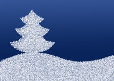 Blue background with a Christmas tree made of snowflakes Stock Images
