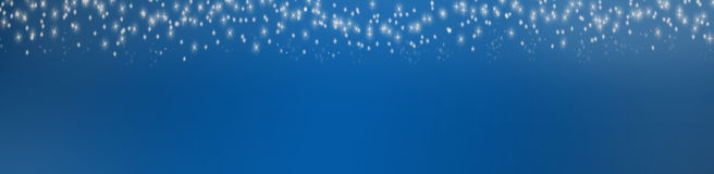 Blue background with christmasstars Stock Photos