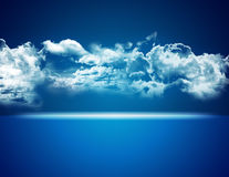 Blue background with clouds Royalty Free Stock Photos