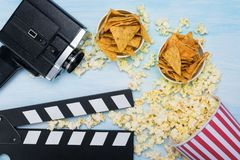 On a blue background the concept of items for filming and watching movies stock photo