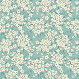 Blue background with cute little flowers. Cute litle flowers seamless pattern Royalty Free Stock Photos