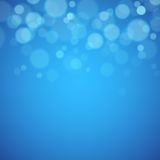 Blue background with defocused lights Royalty Free Stock Photography