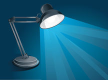 Blue background with desk lamp Stock Photo