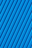 Blue background with diagonal stripes Stock Photography