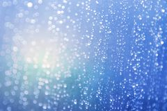 Blue background with drop in rain. In light sun royalty free stock photos