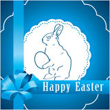 Blue background with Easter bunny Royalty Free Stock Images