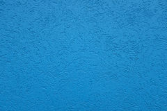 Blue Background With Etched Squiggles. Vivid, rich blue background with unique textured and etched surface.  Stucco type surface with squiggly lines Royalty Free Stock Photography