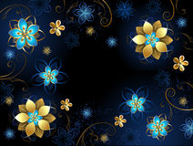 Blue background with flowers. Blue background with gold jewelry and blue flowers Royalty Free Stock Photo