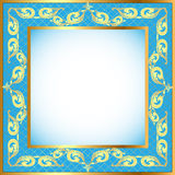 A blue background a frame with a gold pattern Royalty Free Stock Photos