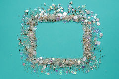 Blue background.Frame made of of sequins and beads Royalty Free Stock Image