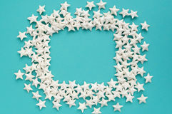 Blue background. Frame made of white stars Royalty Free Stock Photography