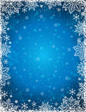 Blue background with frame of snowflakes and stars, vector royalty free stock photography