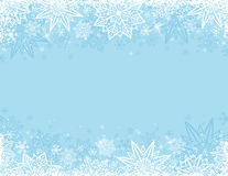 Blue background with frame of snowflakes and stars royalty free stock image