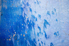 Blue background with ink texture on metal. Blue colored abstract Royalty Free Stock Image