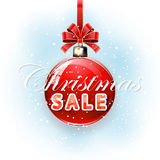 Blue background with inscription Christmas Sale on red ball Stock Image