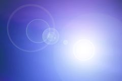 Blue background lens flare Royalty Free Stock Photo