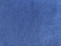 Blue background with linen fabric. Blue background with natural linen fabric for summer clothes. Textile background with linen texture royalty free stock images