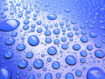 Blue background with lot of rain drops Royalty Free Stock Photos