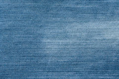 Blue background of old faded denim Stock Photos
