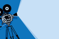 Blue background with old fashioned movie camera Stock Image