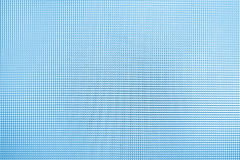 Blue background with the petty texture mesh Stock Image