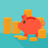 Blue background of piggy bank and golden coins. Royalty Free Stock Photography