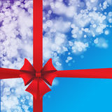 Blue background with red bow Royalty Free Stock Images