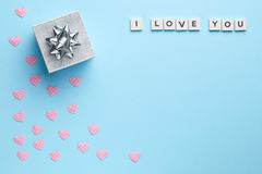 Blue background with rose and heart Stock Photos