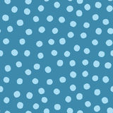 Blue background with scattered round spots. Seamless pattern with dots painted rough brush. Stock Photography