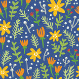 Blue background seamless pattern with colorful flowers. Blue background repeat pattern with colorful flowers Stock Photos