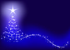 Blue background with shiny Christmas tree. Royalty Free Stock Photography