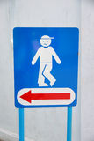 Blue background of signs men's room. Royalty Free Stock Photos