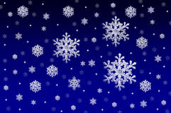 Blue background with snow crystals Stock Images