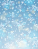 Blue background with snowflake and bokeh Royalty Free Stock Image
