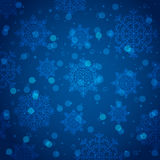 Blue background with snowflake and bokeh, vector Royalty Free Stock Image