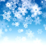 Blue background with snowflakes Royalty Free Stock Images