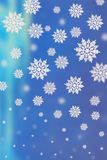 Blue background with snowflakes. 3D blue background with falling down  snowflakes of the different size Stock Photos