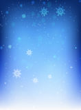 Blue background with snowflakes. Christmas blue background with snowflakes falling Stock Image