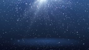 Blue background with snowflakes falling down and ray spBlue background with particles falling down and ray spot loop. stock video footage